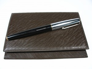 pen on portfolio case